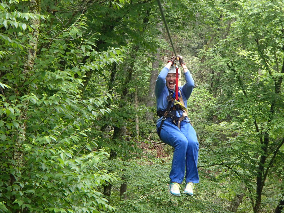 Person on our zip line tour in Boone, NC